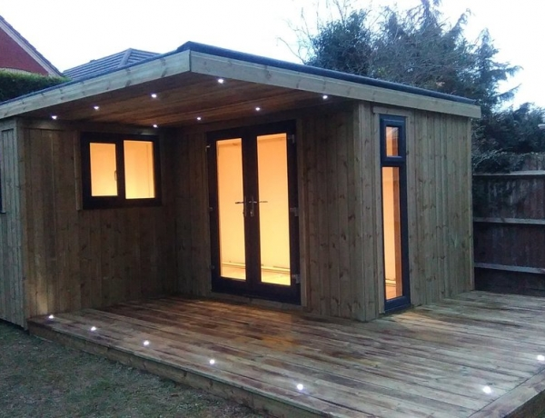 L Shaped Garden Room Accompanied with Burnt Decking